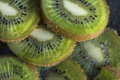 Sliced kiwi fruits on a black background, macro, abstract photography royalty free stock photography