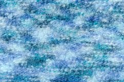 Close up on knit woolen fabric texture. stock image