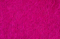Close up on knit woolen fur texture. Royalty Free Stock Image