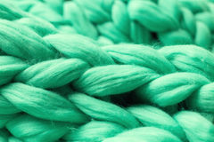 Close-up of knitted blanket. Merino wool background Royalty Free Stock Photography