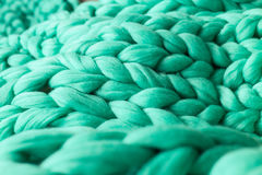 Close-up of knitted blanket. Merino wool background Stock Photos