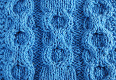 Close-up of knitted cloth with raised tracery Stock Images