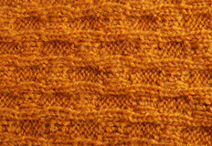 Close-up of knitted cloth with raised tracery Royalty Free Stock Photo
