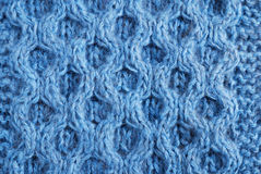 Close-up of knitted cloth with raised tracery Royalty Free Stock Photography