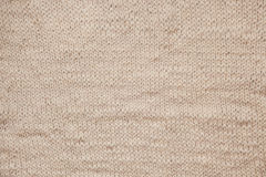 Close up of knitting beige textured wool background, vintage old style. Beige / gray or light brown color knitting wool textured background. Can be used as a Royalty Free Stock Image