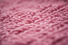 Close up of knitting dirty-pink textured wool background, vintage style. Purple / pink / violet color knitting wool textured background. Can be used as a Royalty Free Stock Photography