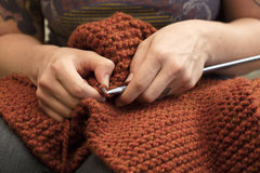 Close Up of Knitting Hands Royalty Free Stock Photography
