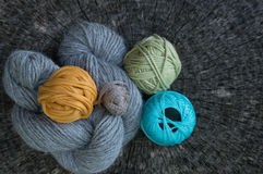 Close Up of Knitting Yarns on Tree Ring Background. Close up shot of knitting yarns on a tree ring background Stock Photography