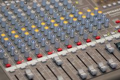 Audio console close-up. Close-up on knobs of an audio console. Digital audio board. Studio workstation. Mixing console royalty free stock images
