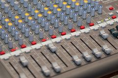 Audio console close-up. Close-up on knobs of an audio console. Digital audio board. Studio workstation. Mixing console stock image