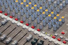Audio console close-up. Close-up on knobs of an audio console. Digital audio board. Studio workstation. Mixing console stock photos