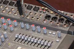 Audio console close-up. Close-up on knobs of an audio console. Digital audio board. Studio workstation. Mixing console royalty free stock photography