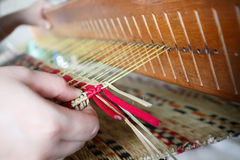 Close up of knot mat with woman hand on woven mat Royalty Free Stock Image