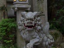 Close up Komainu dog-lionstone statue at the Shrine in Japan. royalty free stock image