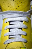 Close-up laces on the yellow boots. Close-up laces on the new yellow boots Royalty Free Stock Photography