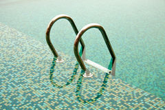 Close-up of ladder in swimming pool Stock Photo