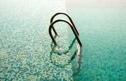 Close-up of ladder in swimming pool Stock Image