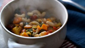 Serving Minestrone Soup stock video footage