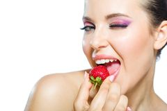 Close up of lady eating strawberry Royalty Free Stock Photo