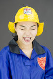 Close up of a lady firefighter shouting Stock Photography