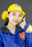 Close up of a lady firefighter showing thumbs up gesture Stock Photo