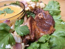 Close-up Lamb chop on salad bed with gravy Stock Images