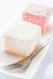 Close up lamington sponge cakes and fork Royalty Free Stock Image