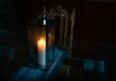 Close-up lamp with burning candle standing on a glass table in a beautiful interior Stock Photography