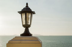 Close up lamp post and sea Royalty Free Stock Photos