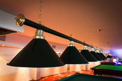 Close up of lamps hang over billiard table Royalty Free Stock Photos