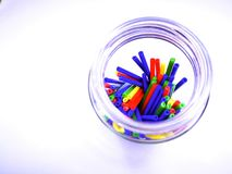 Close-up landscape abstract colorful sticks inside a jar isolated on white background. Stock Photo