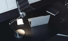 Close up of laptop, lamp and notepad on the table, 3d rendering. Close up of laptop, switched-on lamp and notepad on the table, top view. 3d rendering stock photography