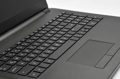Laptop touchpad and keyboard stock photography