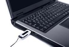 Close up of laptop with usb-flash memory Royalty Free Stock Images