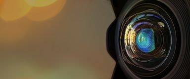 Close up of a large camera lens with bokeh background and copy space . Royalty Free Stock Photos