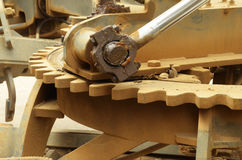close up of large grader gear and grease on join hydrolic lifter Royalty Free Stock Images