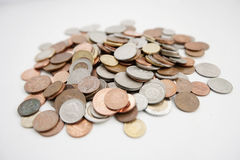 Close-up of large group of coins over white background Stock Images