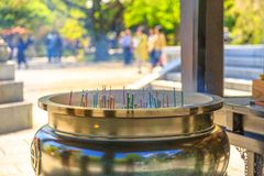 Giant incense burner. Close up of a large Jokoro. A lot of incense sticks burning inside giant bronze incense burner on blurred background. Hase-dera Temple in royalty free stock photos