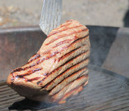 Close up of a large steak on the BBQ grill Stock Image