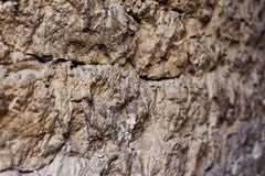 Close up Textured background of a wall of medieval stone masonry. The wall is sloppy built of mountain stones. Medieval. Close up large stones in medieval Royalty Free Stock Photos