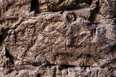 Close up Textured background of a wall of medieval stone masonry. The wall is sloppy built of mountain stones. Medieval. Close up large stones in medieval Stock Images