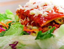 Close up of Lasagana with salad Stock Images