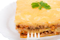 Close-up lasagne on plate with fork Stock Photos