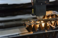 Close-up of the laser cutting machine. Cutting the stainless plate royalty free stock images