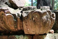 Close up Laterite stone lotus blossom carved in archaeological site of Srithep ancient town at Petchaboon, Thailand. The influence of ancient Khmer culture in Stock Photography