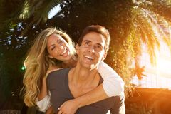 Close up laughing couple in love outside in embrace. Close up portrait of laughing couple in love outside in embrace Stock Image