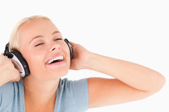 Close up of a laughing woman with headphones Stock Photo