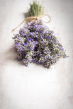 Close up of lavender bouquet over a white wood background. Vintage style. Stock Photos
