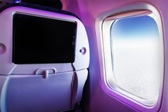 Close-up LCD monitor screen rear seat on the plane technology for entertainment. Airplane seats with screen monitor service for passenger entertainment on Royalty Free Stock Photos