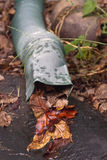 Close Up of Leaf Clogged Rain Gutter Spout Royalty Free Stock Photography